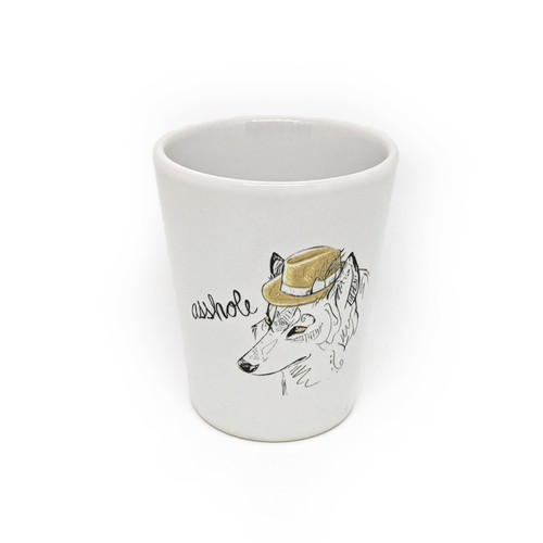 This shot glass holds two ounces, so watch out! You may be cursin' like a wolf faster than you realize.