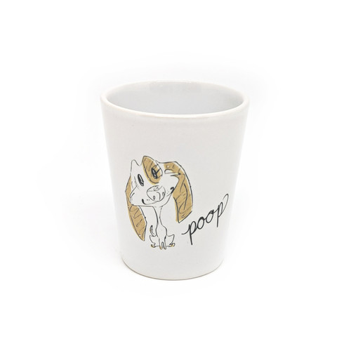 This shot glass holds two ounces, so watch out! You may be cursin' like a puppy faster than you realize.
