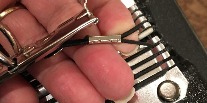 """Loops fit over 1 or more """"fingers"""" in the spine of your folder. Use 2 loops to secure a 3 ring set into a folder (at the top and bottom)"""