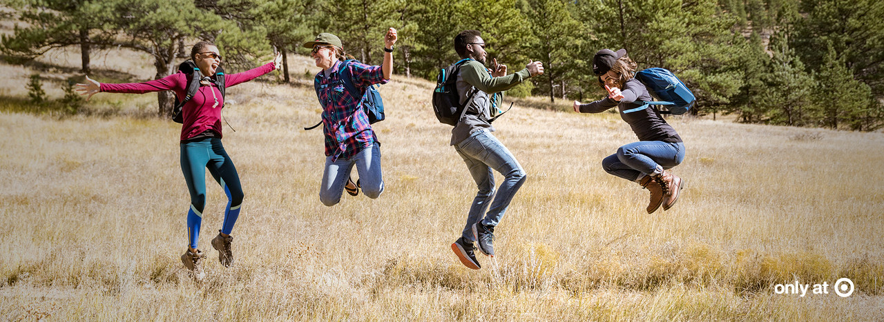 Hikers jumping in a field