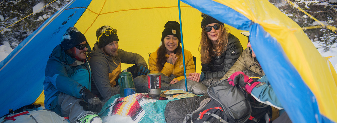 Group of friends not socially distancing in their SD tent