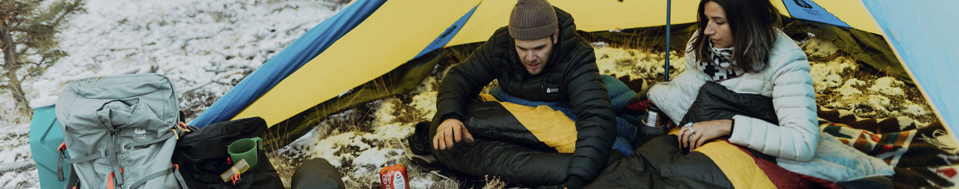 Man and woman enjoying cold weather camping