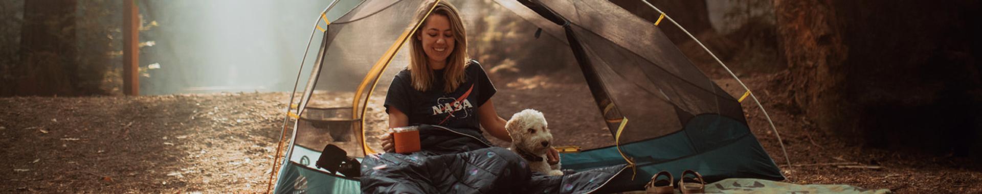 Woman sitting in Sierra Designs tent