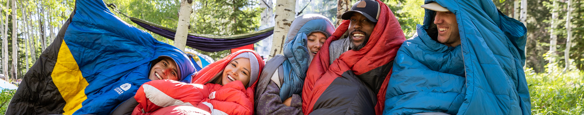 Group of friends wearing Sierra Designs sleeping bags on their heads