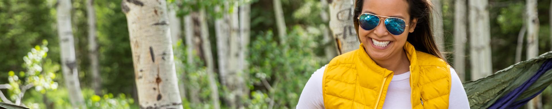 Very happy woman wearing a Sierra Designs vest