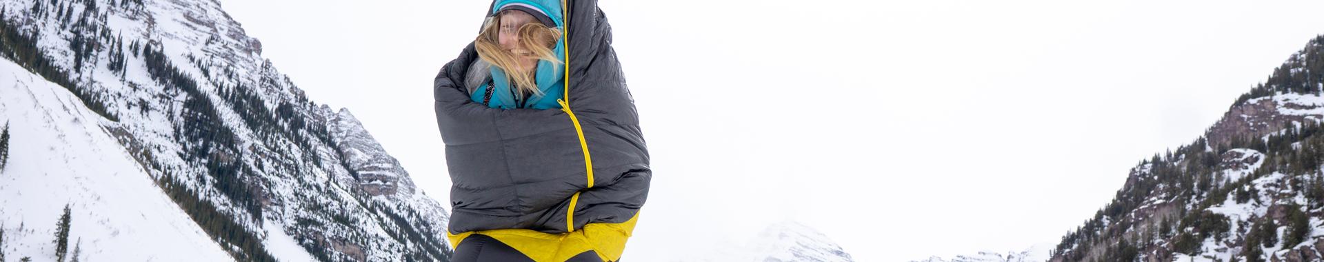 Woman wearing a Sierra Designs sleeping bag