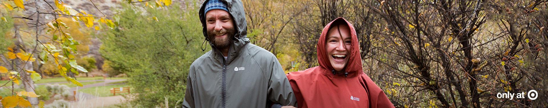 Couple hiking in the rain