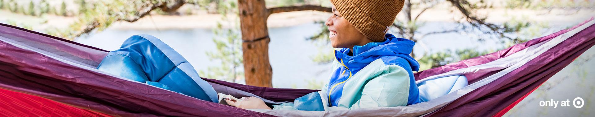 Woman sitting in a Sierra Designs hammock