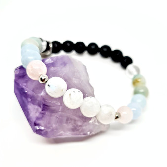 Our sophisticated design combines the healing properties of 5 complimentay crystals that may boost your wombs energy and increase your fertility during natural or IVF process. Encouraging a loving, calm + open environment for your mind, body and spirit to embrace potential change within your physical body. Our bracelet offers a holistic + alternative approach to those journeying through the feritility process. Providing a strong combination of crystals + undyed all natural lava stones you are set for an enlightening journey. Your lava stones are where the aromatherapy comes in. Let your aromatherapist help you find the perfect combination of oils to use throughout the day.  The crystals in our bracelet:  Rainbow Moonstone - 6 - The number 6 in numerolgy represents the embodiment of the heart, unconditional love and the ability to support, nurture, and heal. Feminine strength passed down from this moon like stone is all you need to feel yourself. Rainbow moonstone is a high vibrational stone promoting connections with your higher self as well as reproductive health and wellbeing.  Rose Quartz - 2 - The number 2 in numerolgy represents a remarkablely feminine force of finesse & power. It is cooperative, always aiming to bring peace and balance back to a relationship or situation. Rose Quartz itself is the ultimate stone of unconditional love, your personal talisman when it comes to being prepared for receiving love in all forms and giving love in all forms.  Aquamarine - 4 - The number 4 in numerolgy signfies smart goals: specific, measurable, timeframed, realistic + achievable. That of a meticulousness nature. Aquamarine itself is a natural stress reliver. Deeply connected to the water element representing a state of constant flow, encouraging calm + serenity within. Aquamarine strengthens the aura + encourages fertility as well as awareness of negative emotions and thoughts, accepting and processing these to release them back into the universe.  Our fertility crysta