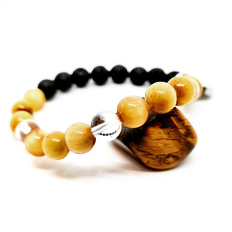 """Yellow Tigers Eye is blessed with amazing depth & can assist in promoting the personal power you already hold within. Strengthening your sense of self, boosting your ability to believe in yourself, to grasp your self-confidence and self-esteem and not let go.  Don't let anyone stop you from doing YOU!  Yellow Tigers Eye aids in decision making, breaking cycles of inaction.  You are strong and courageous, let Yellow Tigers Eye brighten your day and boost your courage & energy everyday.  Zodiac: Leo  Chakra: Solar plexus  Candle Colour: Yellow  Mantra: """"I am strong, courageous and full of energy"""""""