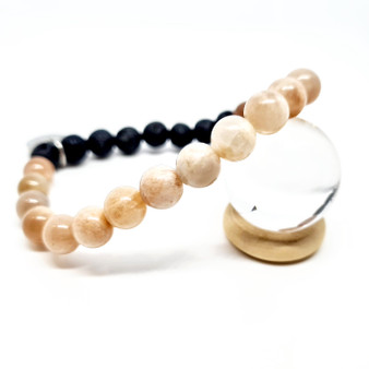 peach moonstPeach Moonstone is suitable for women of all ages to help support hormonal cycles, fertility, menstruation, menopause, ivf. Moonstone is believed to relieve feelings of nausea and relieve food allergies. It is also helpful in encouraging separation from food to emotions and promoting weight loss. one crystal aromatherapy bracelet