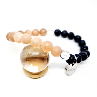 "Image of Raw Peach Moonstone crystal bracelet  Peach Moonstone is suitable for women of all ages to help support hormonal cycles, fertility, menstruation, menopause, ivf. Moonstone is believed to relieve feelings of nausea and relieve food allergies. It is also helpful in encouraging separation from food to emotions and promoting weight loss.  Zodiac: Cancer  Chakra: Sacral   Candle colour: White or peach  Mantra: ""There is no failure. I am worthy and trust in my worth"""