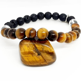 "Enhance your personal power and strengthen your sense of self, your ""inner strength"". Tigers Eye is just a boost to self-confidence and self-esteem, coaxing out the courageous tiger that lies within your firey heart.  Tigers Eye helps you in putting a stop to cycles of in-action, promoting decision making in all areas of your life. Reducing feelings of inadequacy or isolation & restoring your body's emotional balance through stability.   Zodiac: Leo  Chakra: Solar Plexus & sacral  Mantra:  ""I am confident & successful in every thing i do""  Candle colour: Orange, brown, gold  Scents: Geranium, bay, carnation  Vibration: Low"