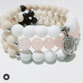 These three beautiful custom bracelets dedicated to promoting love, calm and peace are designed to be worn as a set!   Rose Quartz is the ultimate crystal of universal love. Love your self, love others, accept love and let love fill you. Howlite is the master of calm, positive energy. Encouraging conflict free environments based on practicing the calm you wish to receive. White Jade is the crystal of calm & peace. When one is calm they have the opportunity to think clearly and release negativity and enhance their lives with love and positivity. Fossil is the stone of strength, confidence and calm. Calming, soothing energy that promotes tranquility, comfort and self-confidence. Fossil is a grounding stone, which means it can create stability in your self and within your life.