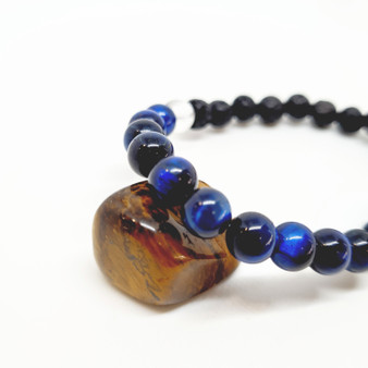 Blue Tiger Eye is the result of tiger's eye and the related blue-coloured mineral hawk's eye. Flashy, lustrous appeal from theparallel intergrowth of quartz crystals and altered amphibole fibres that have mostly turned into limonite. Blue Tiger Eye is a stone of transistion, deep protection, power + perseverance. Surround the aura with fiery confidence + push to reach new stages of life, while remaining grounded and focused. It opens up the third eye to bring calmness, and intuition. Its frequency brings mental clarity by balancing the body's hormones to release tensions that hinder your journey.  Zodiac: Capricorn & Leo  Chakra: Throat + Third Eye  Candle Colour: Blue  Located: Western Australia