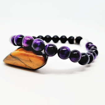 Natural Tiger Eye dyed purple allows for deep personal balance + insight. Purple Tiger Eye is a talisman of mental power & deep intuition. Assisting in attracting wealth + increasing devotion through soothing differences. Build your success, satisfaction, leadership + authority with the help of Purple Tiger Eye.  Zodiac: Leo + Capricorn  Chakra: Third Eye + Throat  Candle Colour: Purple