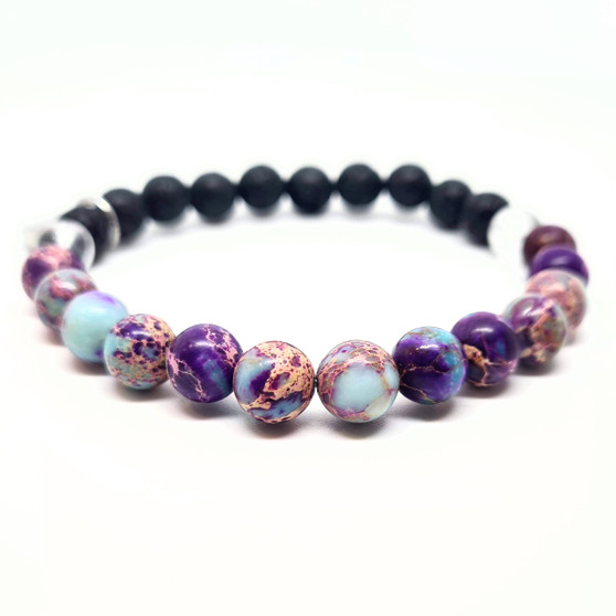 Purple sea sediment jasper is an attractive stone with an abundance of depth. Providing soothing protection from negativity whilst encouraging peace in  life. Carrying a strong connection to the earth's energy, it is believed to fight fatigue and exhaustion.