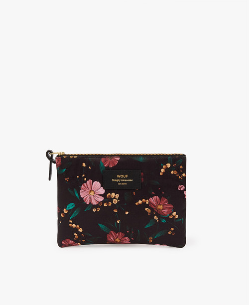 This WOUF zipper bag is perfect for a makeup bag or a small clutch to carry your keys and phone.