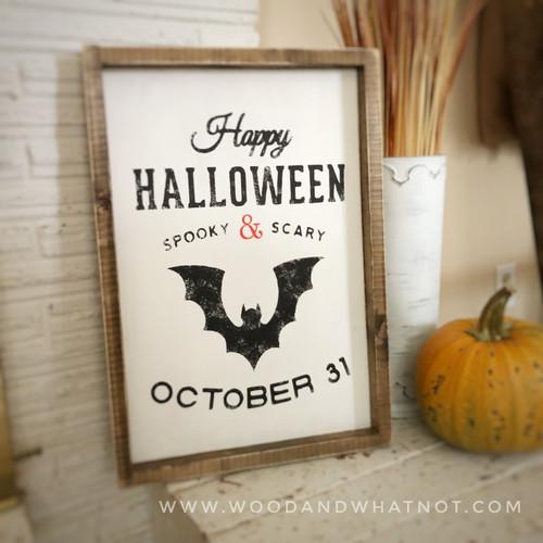 Happy Halloween sign with bat
