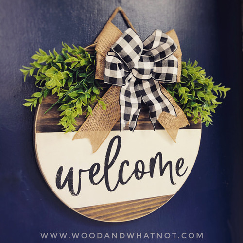 Welcome door hanger with bows and greenery