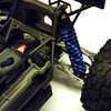 X-MAXX shock boots mounted on the stock truck.