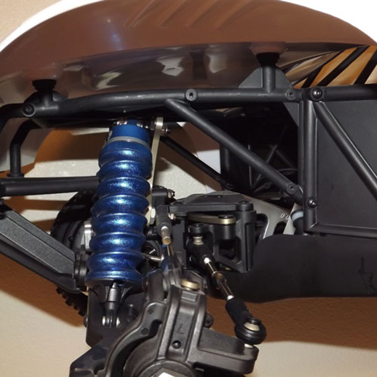 This is the area on the front of the losi 5ive-T that allows dirt into the pan of the chassis.