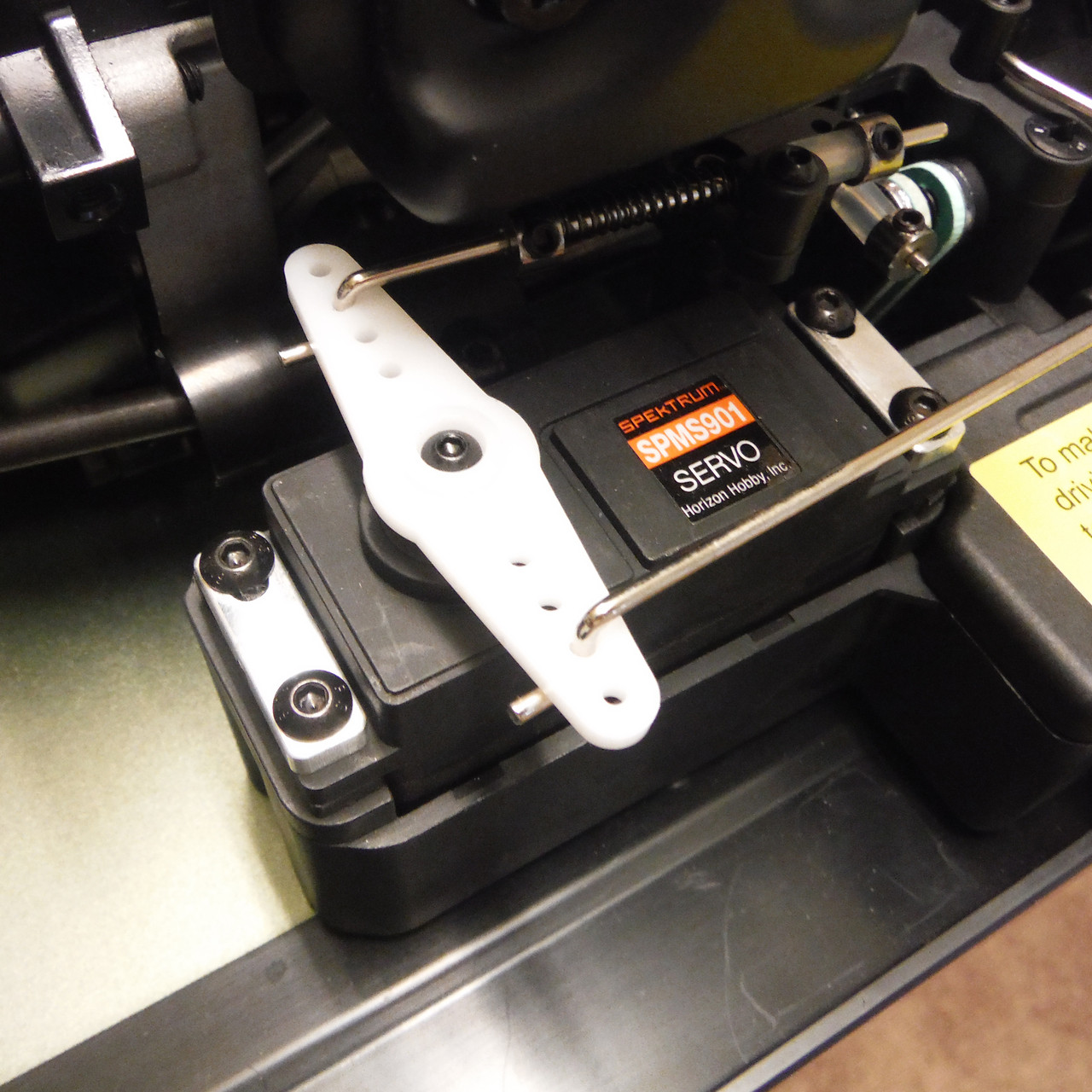 DBXL servo clamps shown mounted on the throttle/brake servo.