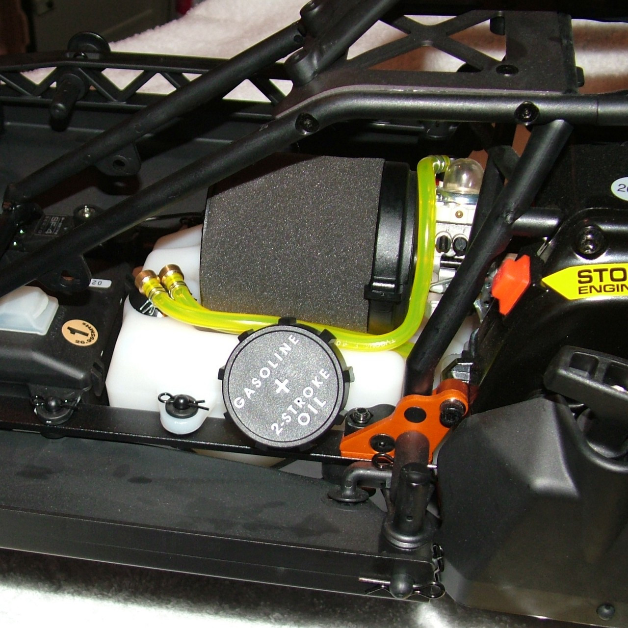 Shown here mounted on an HPI Baja 5T truck.  You can see the clean routing of the fuel lines.