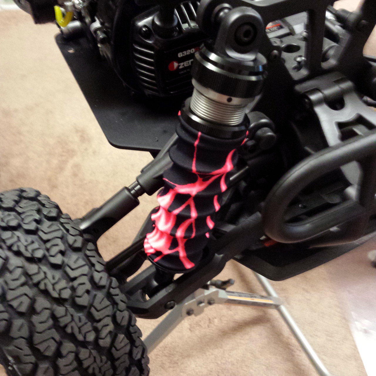 Vekta 5 sporting some hot Lightning Red shock boots on the front end!