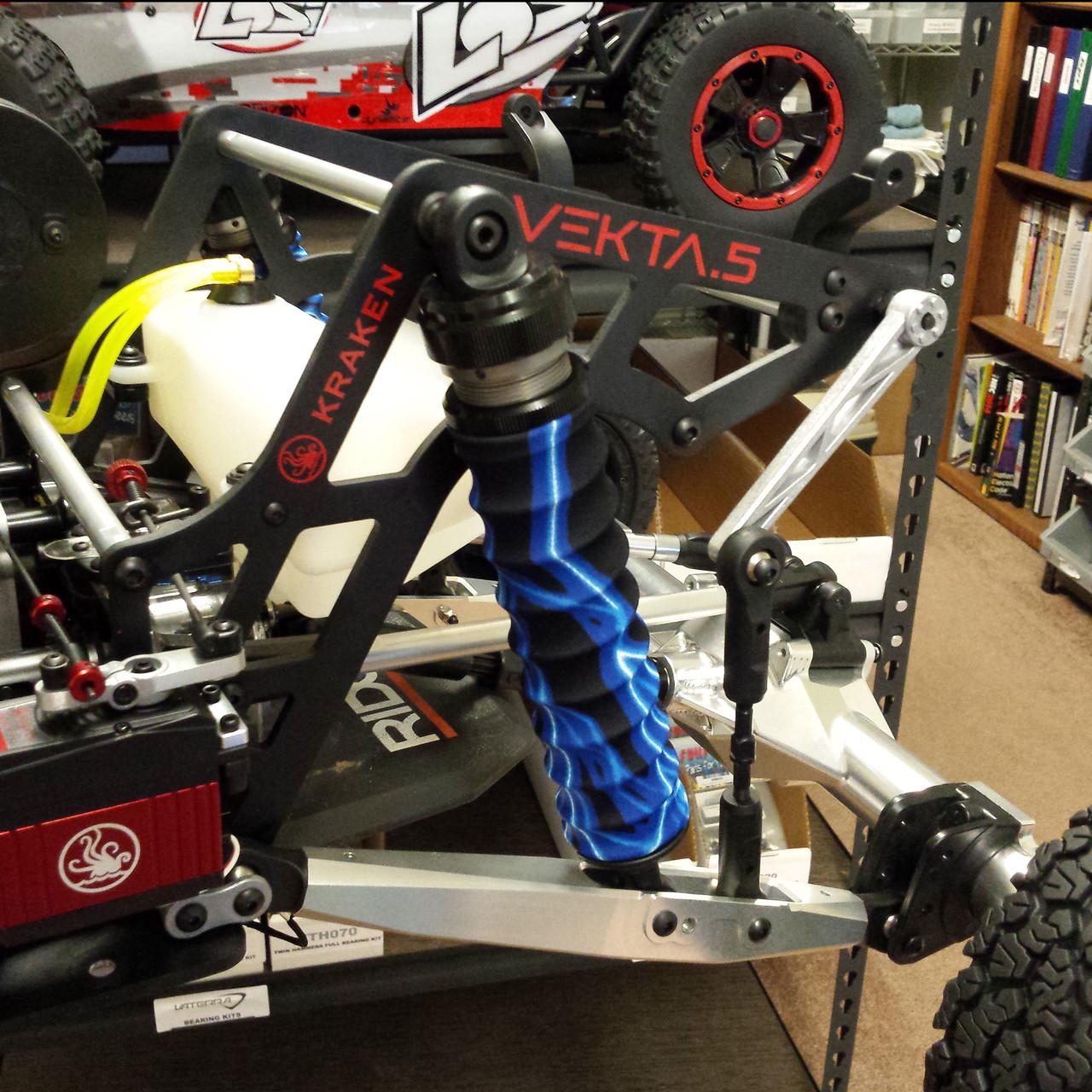 Lightning Blue Shock covers mounted on the stock Vekta.5 Rear shocks.