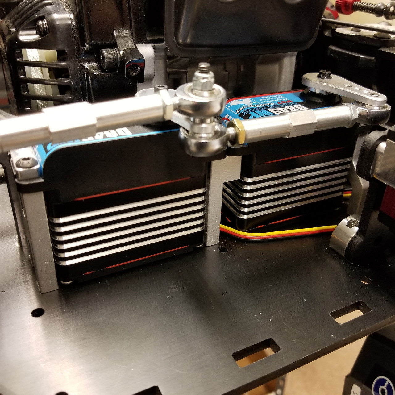 Shown here installed with a pair of Hitec HS845WP servos as well as a front link from IRP.