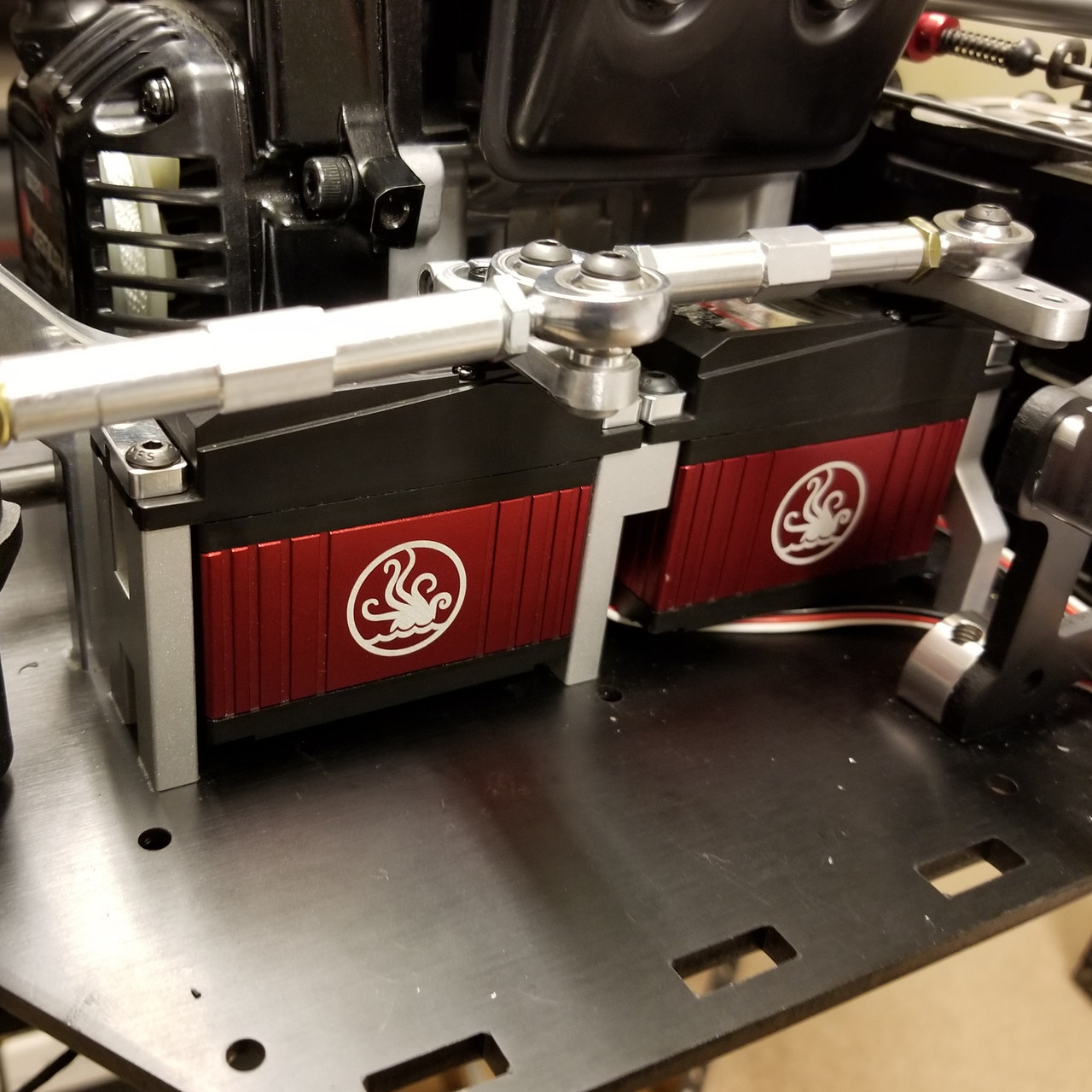 Shown here installed with a pair of Stock Kraken servos as well as a front link from IRP.