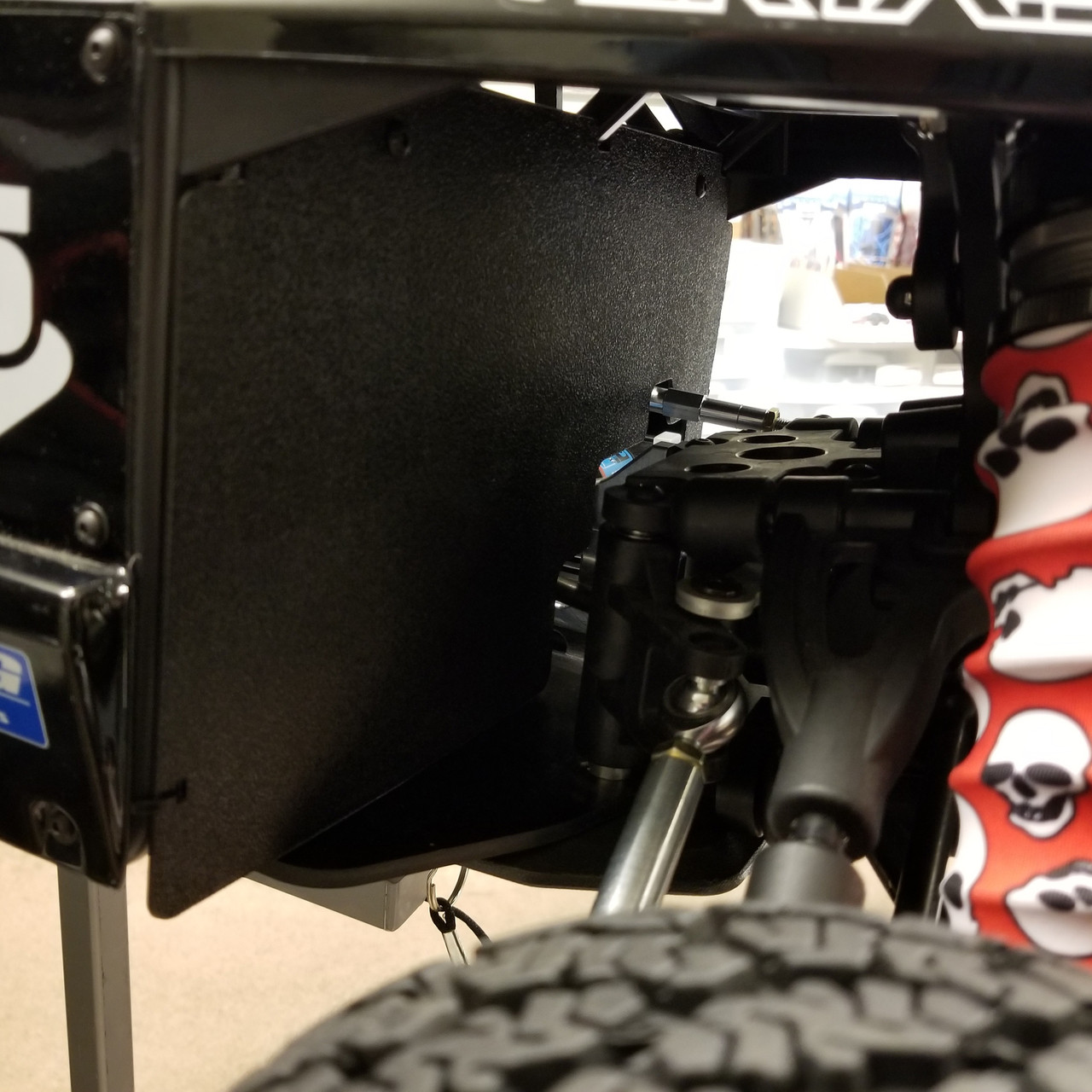 Mudguard fits tightly right in the middle of the Vekta.  Picture shows out Black ABS Mudguard.
