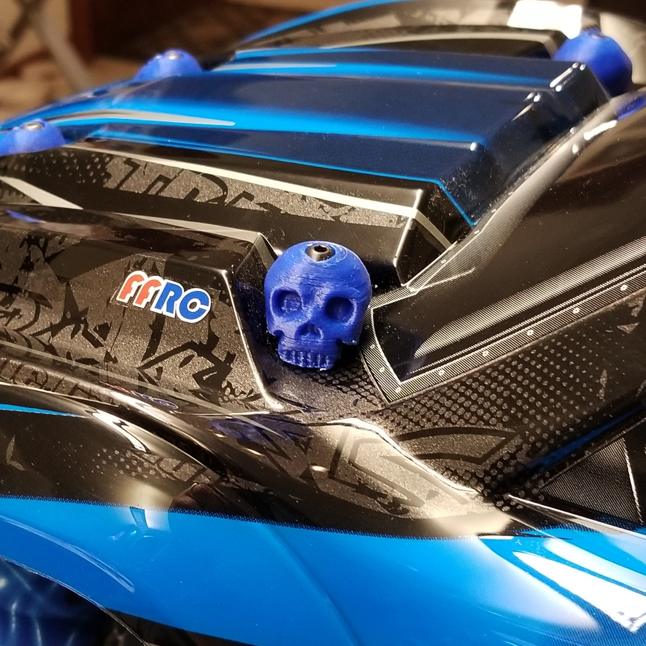 X-MAXX Skull Body washers by Fullforce RC.  Showing the Driver side in Blue.