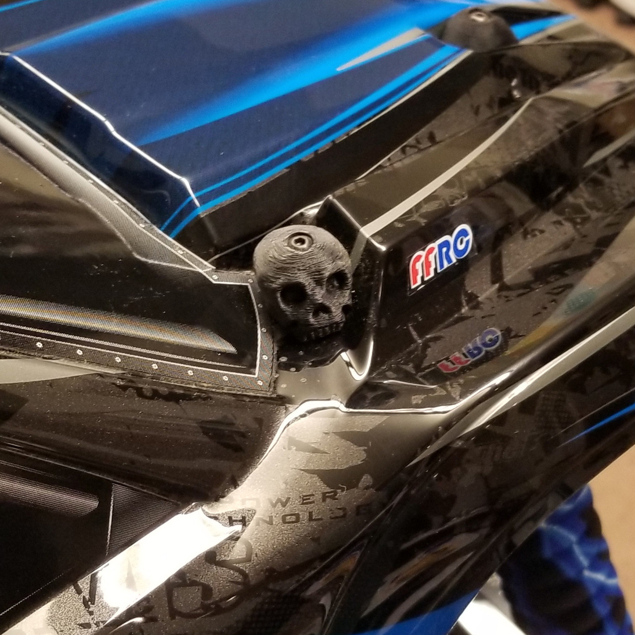 X-MAXX Skull Body washers by Fullforce RC.  Showing the Driver side in Back.