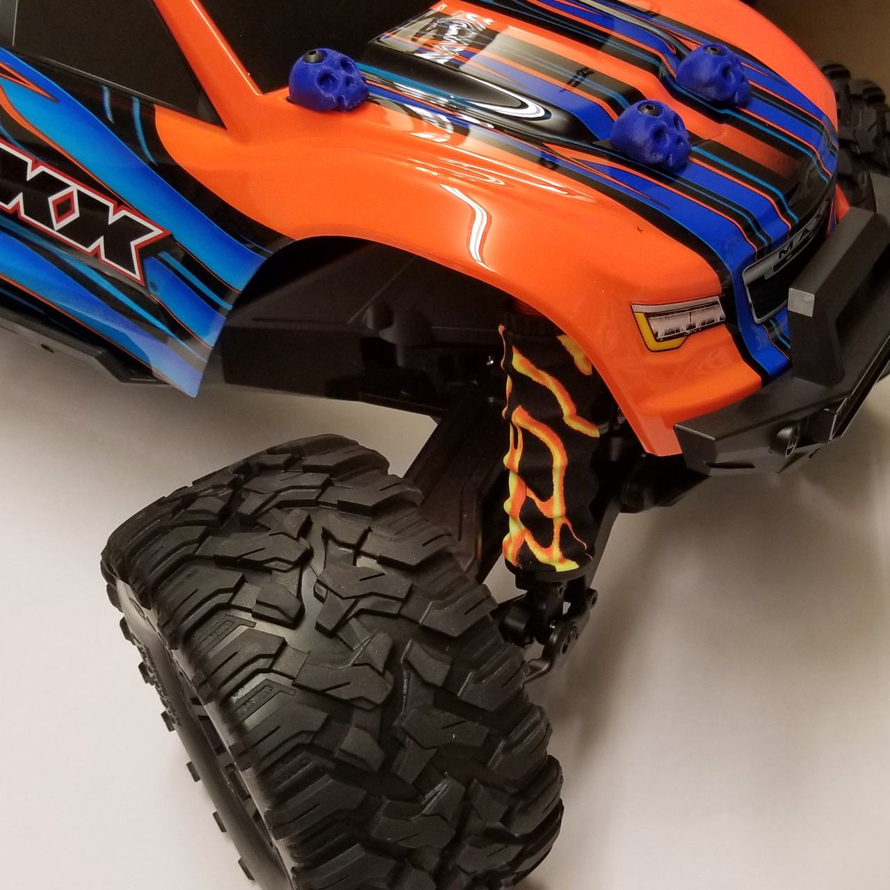 Lightning Orange/Yellow shock boots on our shop Traxxas MAXX truck!