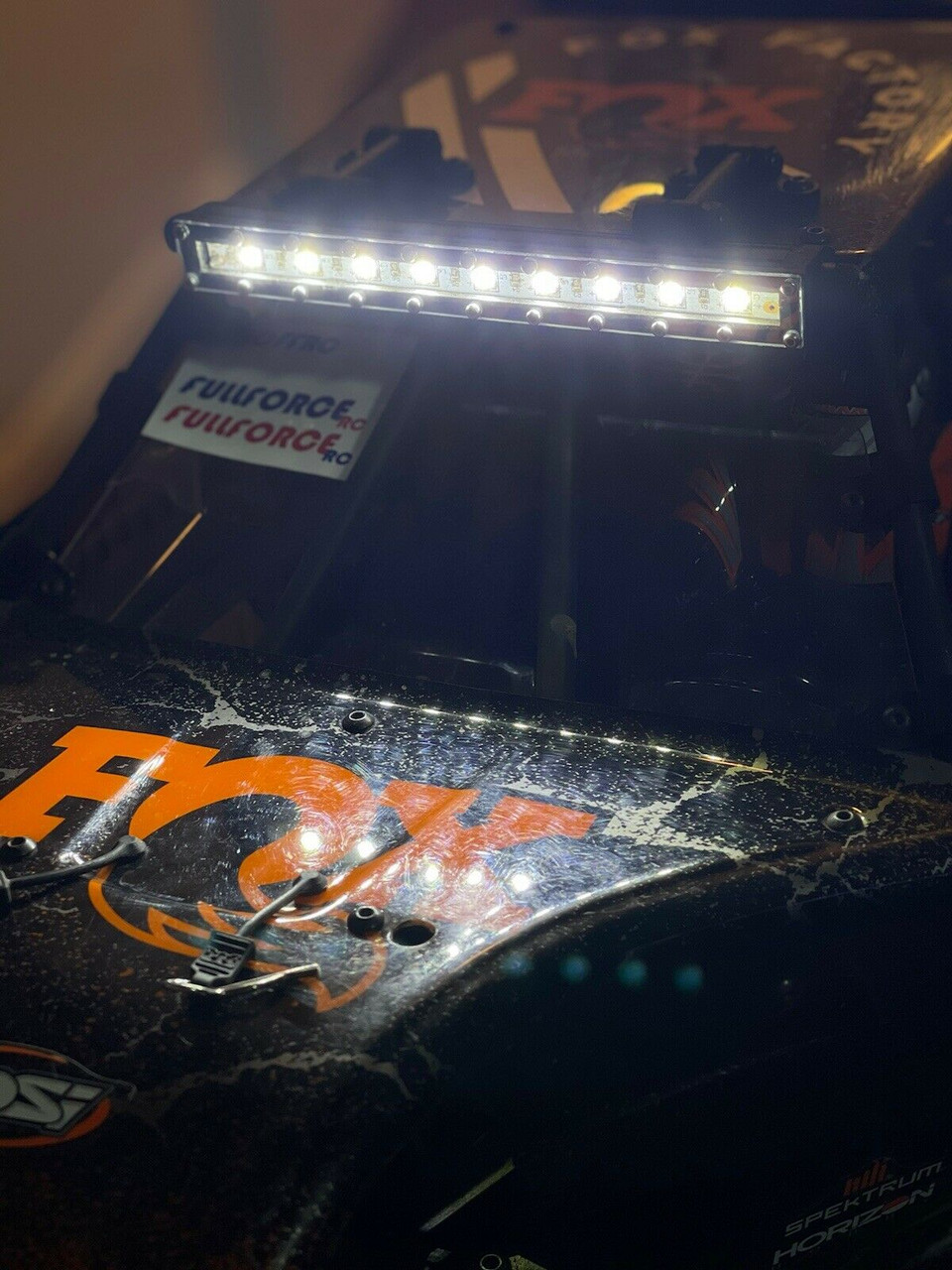 Shown here lit up on our first customers ride! Protects the LED strip and keeps the dirt and debris from getting crammed in there.