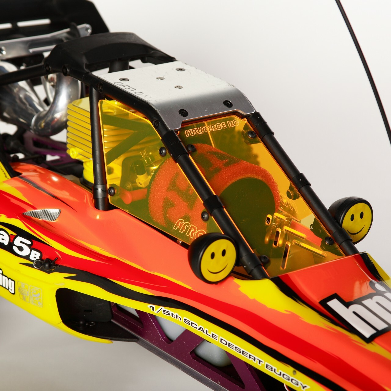 HPI Baja 3 piece windows shown installed on a stock RTR truck!.  Shown are the Transparent Orange.
