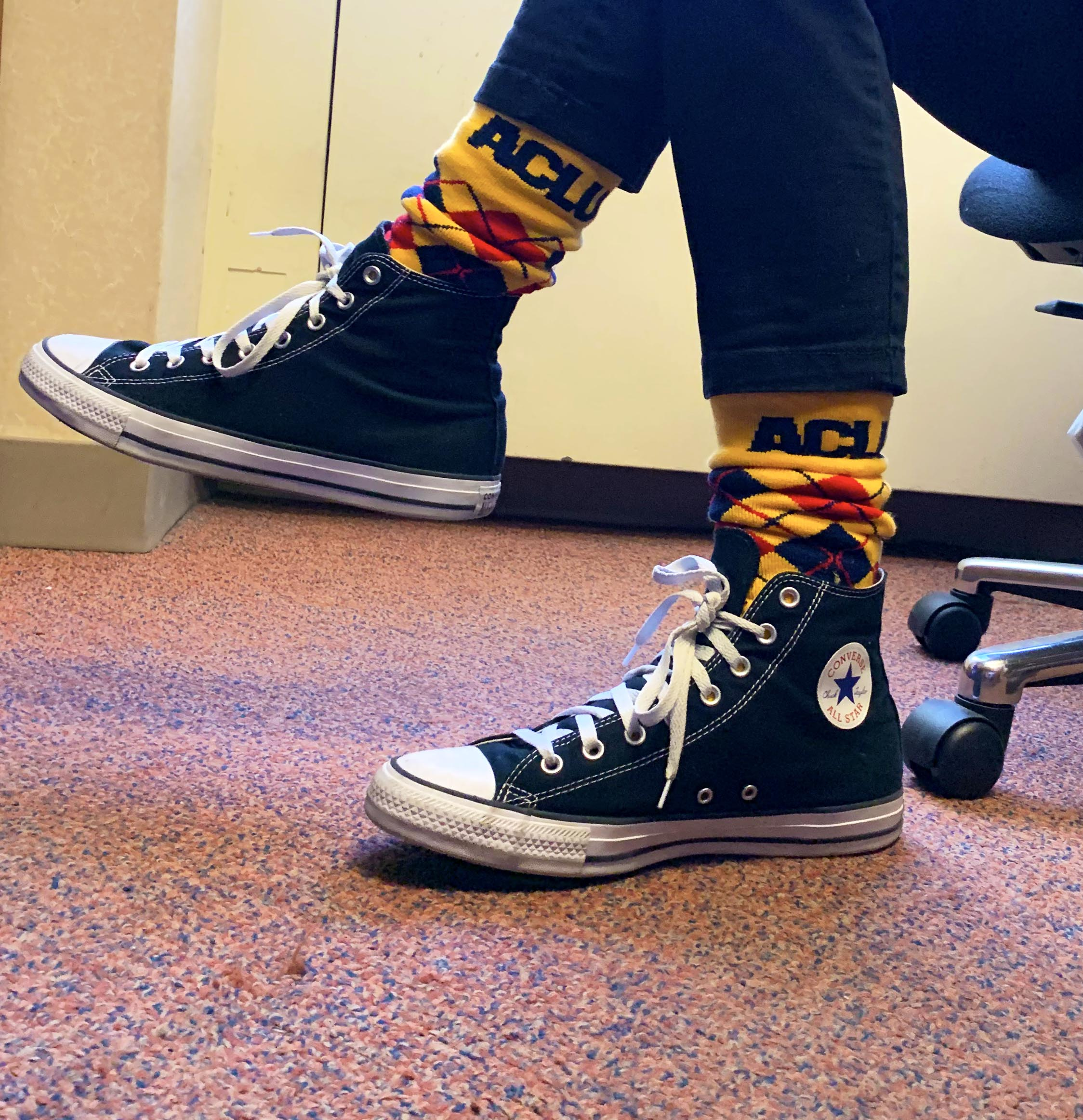 Yellow argyle socks on at office