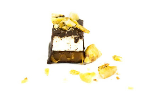We've finally gone bananas, but only a little bit! You'll love this playful new mini candy bar flavor with banana rum caramel, vanilla bean marshmallow and 66% dark chocolate. 1.5 oz. These are constantly selling out in our shop. Tuck one in your purse for emergencies!