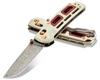 "BENCHMADE 486-201 SAIBU NAKAMURA DESIGN AXIS FOLDER. 2.98"" PLAIN EDGE DAMASTEEL BLADE. IVORY G-10 HANDLE W/CRIMSON G-10 INLAY. GOLD CLASS"