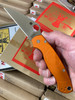 SPYDERCO LYNCHNW PARA MILITARY 2. CPM-S30V WHARNCLIFFE BLADE. ORANGE ANODIZED ALUMINUM HANDLE. LYNCH TI POCKET CLIP. LIMITED EDITION. SHOWN IN HAND. CUTLERY SHOPPE EXCLUSIVE.