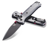 """BENCHMADE 535BK-4 BUGOUT AXIS LOCK FOLDER. 3.24"""" BLACK CERAKOTE FINISH M390 DROP POINT BLADE. 6061-T6 ALUMINUM HANDLE. RED BARREL SPACERS AND DUAL THUMB STUD. REVERSIBLE BLACKENED STAINLESS STEEL POCKET CLIP. CUTLERY SHOPPE"""