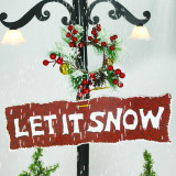 Fraser Hill Farm Let It Snow Series 47-In Red Santa with Green Umbrella Base, Animated Musical Snow Decoration