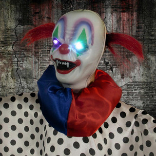 Haunted Hill Farm Life-Size Animatronic Spooky Clown with Light-up Colorful Eyes and Spinning Movement
