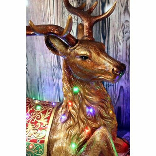 Fraser Hill Farm 4-Ft Tall Sitting Reindeer with Metallic Finish with Long-Lasting LED Lights, Indoor or Outdoor