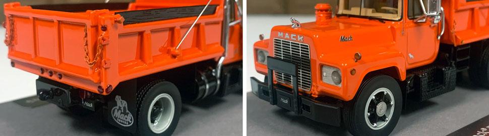 Closeup pictures 1-2 of the Mack R dump truck scale model in orange over black.