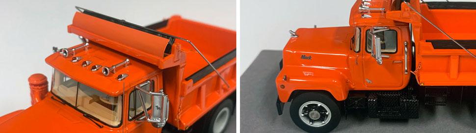 Closeup pictures 11-12 of the Mack R dump truck scale model in orange over black.