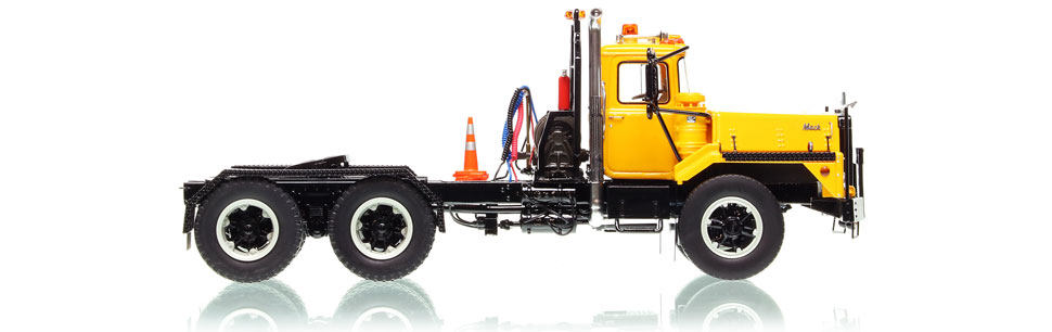 Mack DM 800 tandem axle tractor scale model in yellow over black