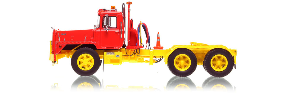 1:50 scale model of Mack DM 800 tandem axle tractor in red over yellow